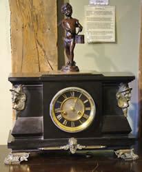 French eight day striking brass mounted slate clock