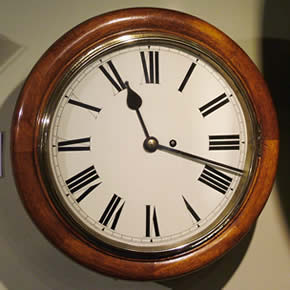 Early 20th century mahogany dial clock